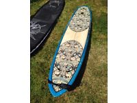 Longboard. Performance shaped by Jason Burnett. Excellent condition.