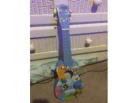 Small blue adventure time ukulele