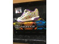 Size 12 unisex emoji design genuine heelys - used once excellent condition with box and instructions