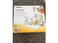 Medela swing breast pump essentials pack unopened
