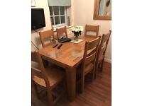Solid Oak extendable table and 6 solid oak chairs