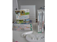 Nintendo Wii, 2 controllers and 9 games