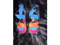 Multi coloured wedges size 4 , one worn but look brand new. Perfect for summer !