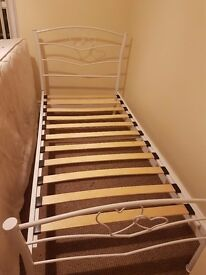 **White single bed frame with heart detail**