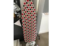 Brand new iron and used ironing board
