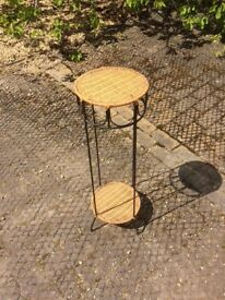 A Round Iron and Wicker Stand
