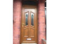 PVC Door with Arch Rose window.