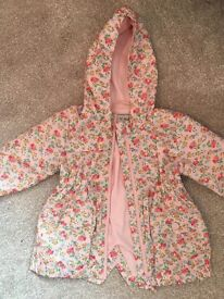Next Floral Rain Mac. Size 9-12 Months.