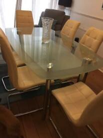Glass table and six dining chairs