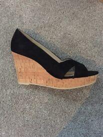 Women's black wedge shoes