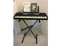 YAHAHA ELECTRIC KEYBOARD, PIANO, AND STAND.PERFET CONDITION.