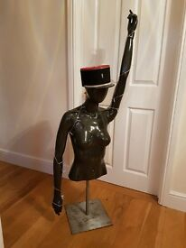 Mannequin art feature with lighting and french military cap