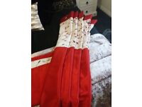 Red curtains with cream border detail