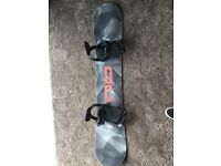 USED ONCE. DC focus 2016 snowboard , with fix bindings and route one travel bag with wheels