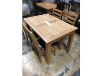 Solid wood dining table and 4 chairs - As new