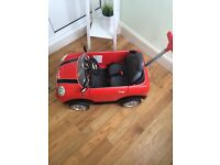 Red mini push along car..with bar and sounds great condition no marks hardly usef