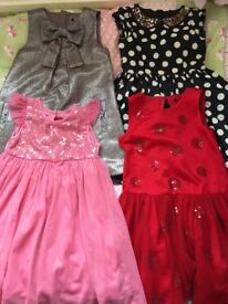 4 stunning Next and Marks & Spencers dresses, aged 6. Excellent condition.