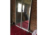 Sliding mirror wardrobe doors