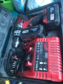 Milwaukee drill for sale used condition but works fine 2 batteries and charger with box