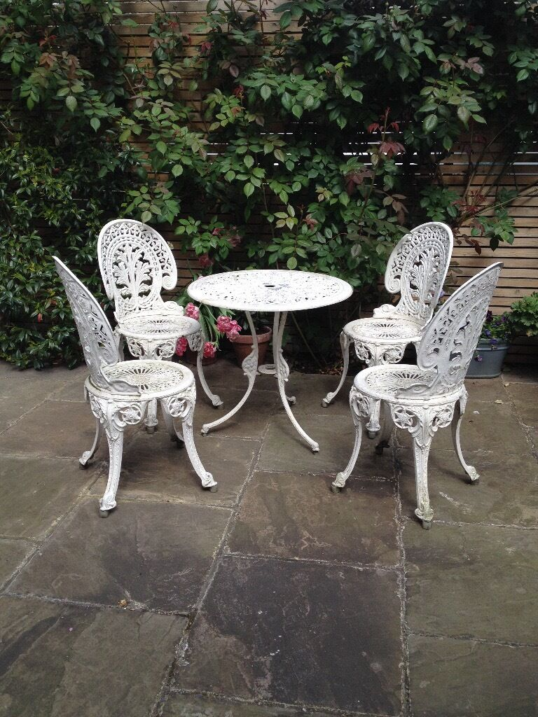 Pretty Cast Aluminium Garden Furniture Table And Four Chairs