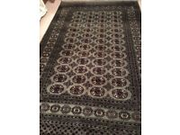 Green, red, black and cream signed Persian rug