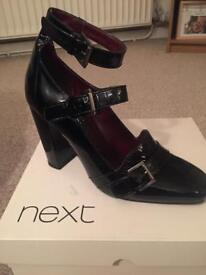 Black patent buckled shoe