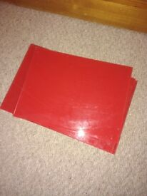 Red glass table mats