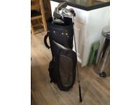 Golf bag and set of Wilson clubs in good condition with 7 clubs including a 3 and 4 hybrid iron