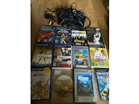 PlayStation 2 mini with 12 games 2 controllers