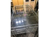 Free glass table and three chairs