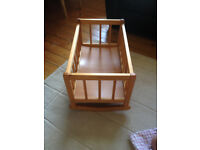 Dolls bundle of wooden rocking cot/crib, mammas and papas carry cot, changing mat and dolls