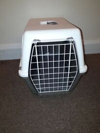 Large plastic pet carrier with cushion. Excellent condition.