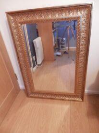 Gold swept mirror