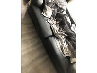 Three seater and two seater black leather sofa