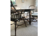 great condition - Dark Oak oval table and 6 chairs (2 are carver chairs)