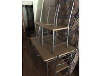 Dining table and 4 chairs immaculate condition delivery available