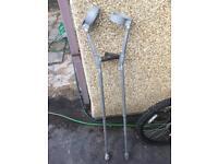 1 pair silver crutches.
