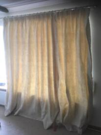 Beige pleat lined curtains