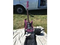 ELECTRIC GUITAR WITH AMPLIFIER AND CARRY CASE