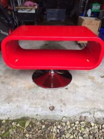 TV Stand Red in Colour on Chrome Base.