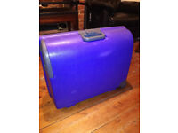 Carlton hard plastic suitcase on wheels blue / purple