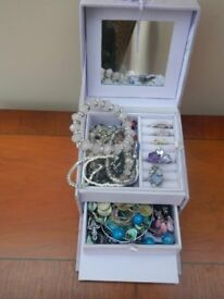 Box containing a range of costume jewellery