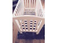 Beautiful condition white solid wood mothercare dropside cot.