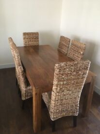 Large oak table and 6 rattan chair.