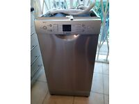 practically new silver Bosch Exxcel slimline dishwasher can deliver