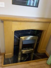 Oak fire surround and seperate electric coal fire
