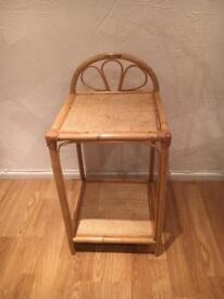 Small tiered rattan unit with 2 shelves and detail