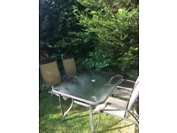 5ft x 3ft glass garden table , 6 reclining chairs, 2 footstools, parasol stand, small coffee table