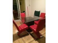 Dining table and 4 red leather chairs. Good condition