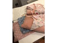 Beautiful mixtures of bunting, vintage style cushion covers and cushions.